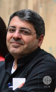 """Father Ziad Hilal: '' It is the same situation, our country is divided now. I think the only way is dialogue between Syrian and Syrian, because of the issues of the day, because with weapons – we could not find a resolution. We have to stop the weapons and work for peace. This is the most important thing for us as Syrians."""""""