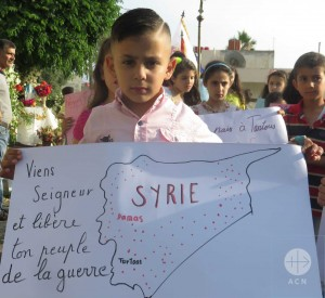 "Christian children (of the various denominations) gathering together in Tartous for peace procession, prayer and activities on the ""International Day of the Child"" on 1th of June 2016: ""Viens Seigneur et libre ton people de la guerre (en Syrie) - Come Lord and free your people from the war (in Syria)"" a boy carrying this message during the Peace procession in Tartous. SYRIA / LATTAQUIE-MAR 15/00096: Emergency help for paying for medication for the internally displaced and poor Christians see also ACN-20160608-41932.pdf for all files"